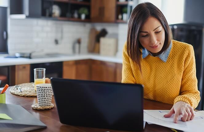 Woman working from home on a laptop computer